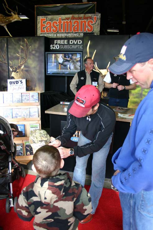 signing-a-young-hunters-hat.jpg